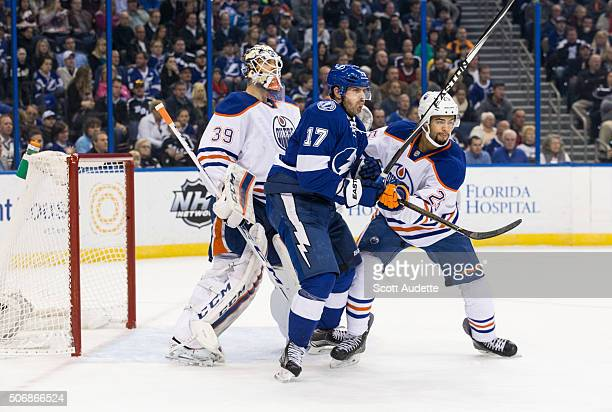 Alex Killorn of the Tampa Bay Lightning battles in front of goalie Anders Nilsson of the Edmonton Oilers against Darnell Nurse during the first...