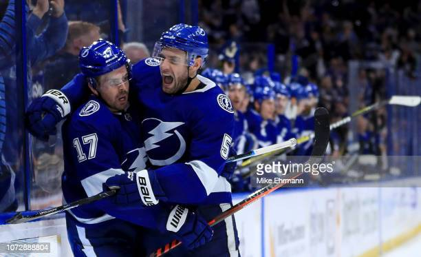 Alex Killorn of the Tampa Bay Lightning celebrates a goal with Dan Girardi during a game against the Toronto Maple Leafs at Amalie Arena on December...