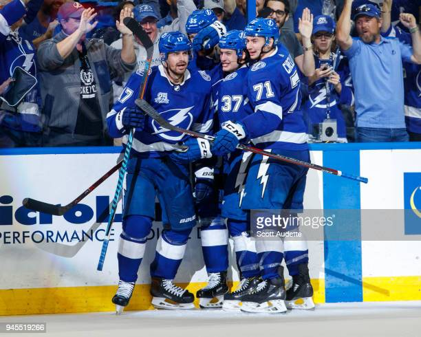 Alex Killorn of the Tampa Bay Lightning celebrates his goal with teammates Anthony Cirelli Yanni Gourde and Braydon Coburn and against the New Jersey...