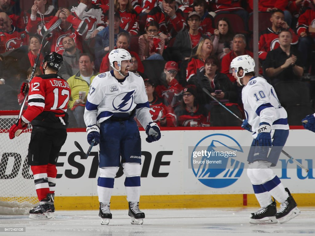 Alex Killorn #17 of the Tampa Bay Lightning (l) celebrates his powerplay goal at 1:42 of the second period against the New Jersey Devils and is joined by J.T. Miller #10 (r) in Game Three of the Eastern Conference First Round during the 2018 NHL Stanley Cup Playoffs at the Prudential Center on April 16, 2018 in Newark, New Jersey.