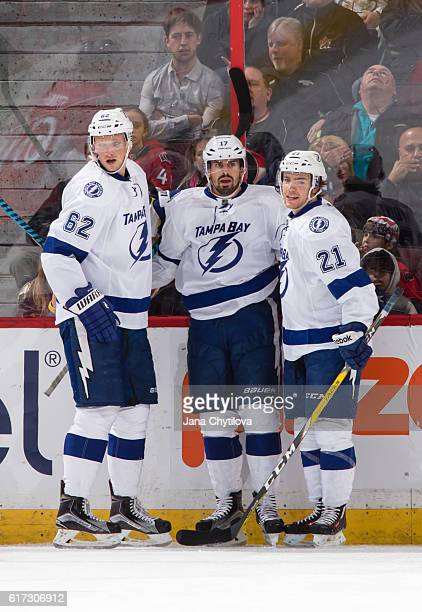 Alex Killorn of the Tampa Bay Lightning celebrates his third period goal against the Ottawa Senators with team mates Andrej Sustr and Brayden Point...