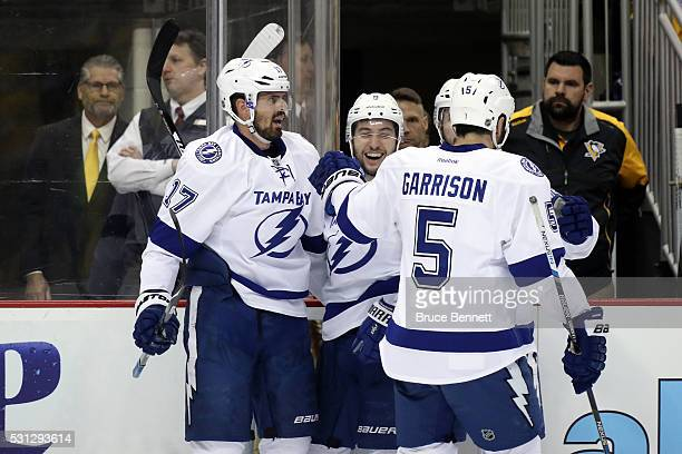 Alex Killorn of the Tampa Bay Lightning celebrates with his teammates Tyler Johnson Nikita Kucherov and Jason Garrison after scoring a goal late in...