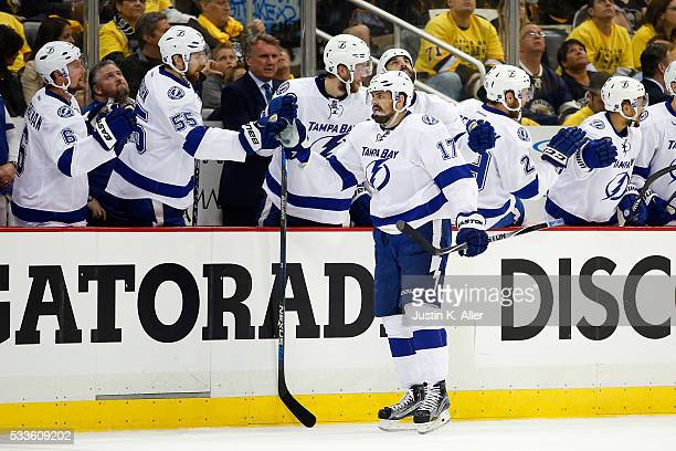 Alex Killorn of the Tampa Bay Lightning celebrates with his teammates after scoring a goal against MarcAndre Fleury of the Pittsburgh Penguins during...
