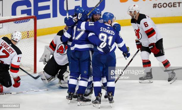 Alex Killorn of the Tampa Bay Lightning celebrates with teammates after a goal against Ben Lovejoy and goalie Keith Kinkaid of the New Jersey Devils...