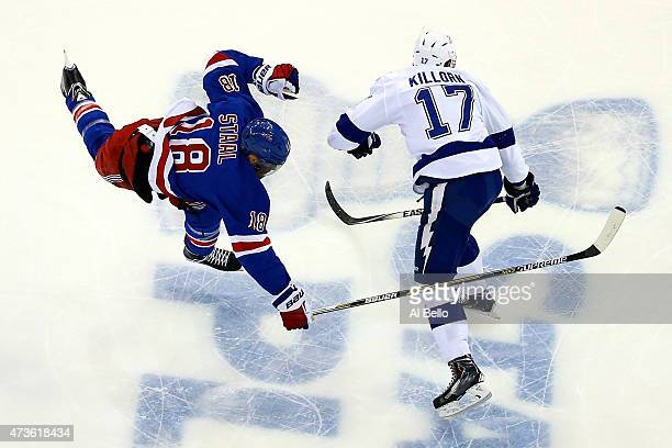 Alex Killorn of the Tampa Bay Lightning checks Marc Staal of the New York Rangers in the first period of Game One of the Eastern Conference Finals...