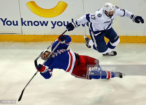 Alex Killorn of the Tampa Bay Lightning collides with Dan Boyle of the New York Rangers in the first period of Game Seven of the Eastern Conference...