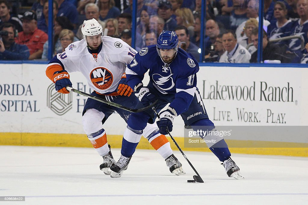 Alex Killorn #17 of the Tampa Bay Lightning controls the puck against Alan Quine #10 of the New York Islanders during the third period in Game Two of the Eastern Conference Second Round during the 2016 NHL Stanley Cup Playoffs at Amalie Arena on April 30, 2016 in Tampa, Florida.