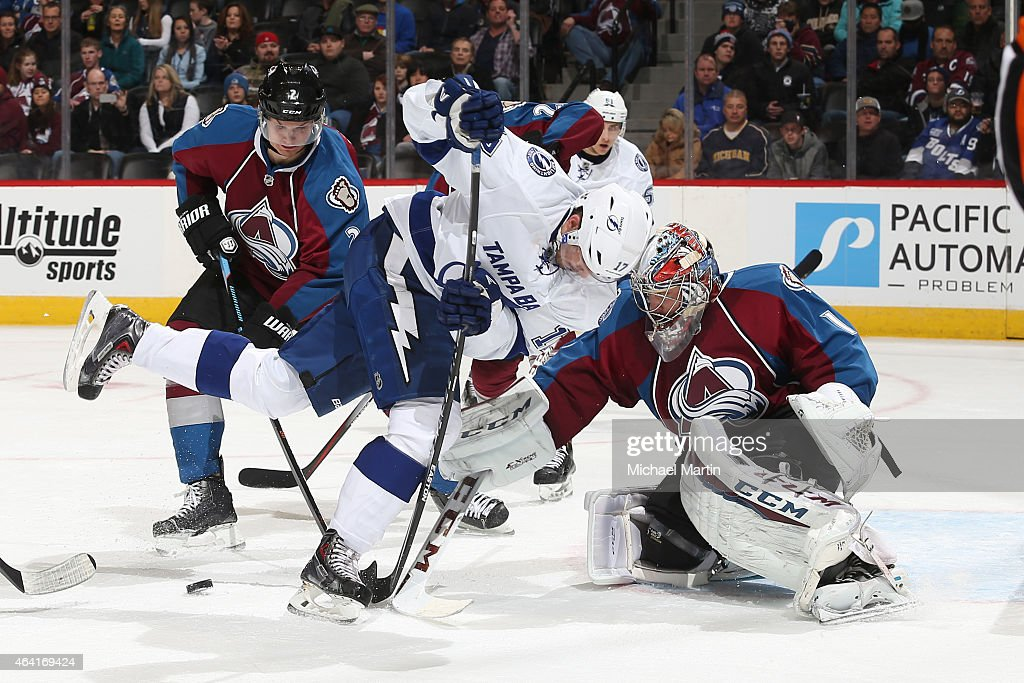 Alex Killorn #17 of the Tampa Bay Lightning fights for the puck against goaltender Semyon Varlamov #1 and Nick Holden #2 of the Colorado Avalanche at the Pepsi Center on February 22, 2015 in Denver, Colorado.