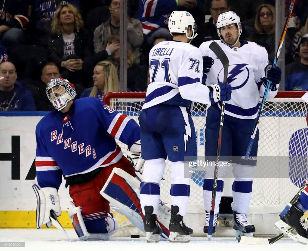 Alex Killorn #17 of the Tampa Bay Lightning is congratulated by teammate Anthony Cirelli #71 after he scored in the second period as Ondrej Pavelec #31 of the New York Rangers reacts on March 30, 2018 at Madison Square Garden in New York City.