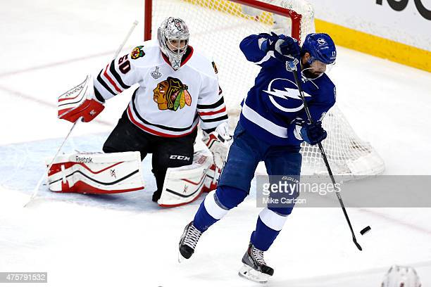 Alex Killorn of the Tampa Bay Lightning scores a first period goal against Corey Crawford of the Chicago Blackhawks during Game One of the 2015 NHL...