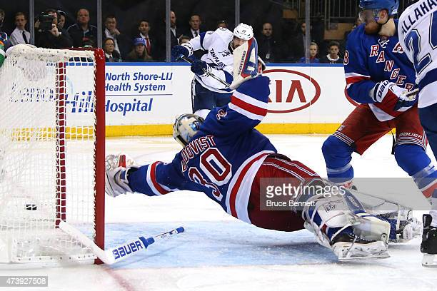 Alex Killorn of the Tampa Bay Lightning scores a goal in the third period against Henrik Lundqvist of the New York Rangers during Game Two of the...