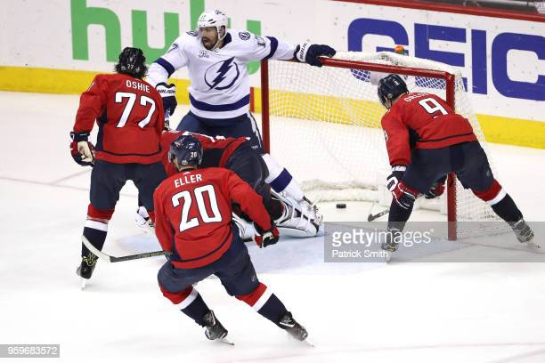 Alex Killorn of the Tampa Bay Lightning scores a goal on Braden Holtby of the Washington Capitals during the third period in Game Four of the Eastern...
