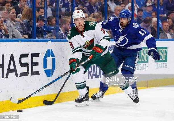 Alex Killorn of the Tampa Bay Lightning skates against Nate Prosser of the Minnesota Wild during the third period at Amalie Arena on March 9 2017 in...