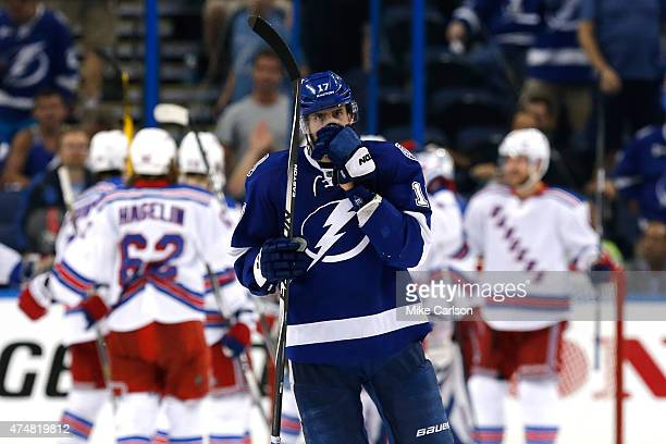 Alex Killorn of the Tampa Bay Lightning skates off the ice as The New York Rangers celebrate after defeating the Tampa Bay Lightning 7 to 3 in Game...