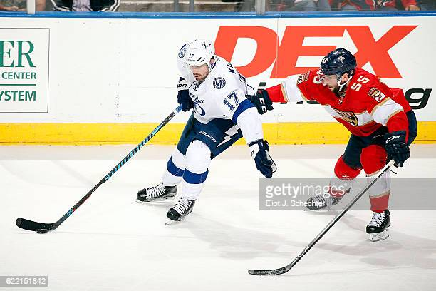 Alex Killorn of the Tampa Bay Lightning skates with the puck against Jason Demers of the Florida Panthers at the BBT Center on November 7 2016 in...