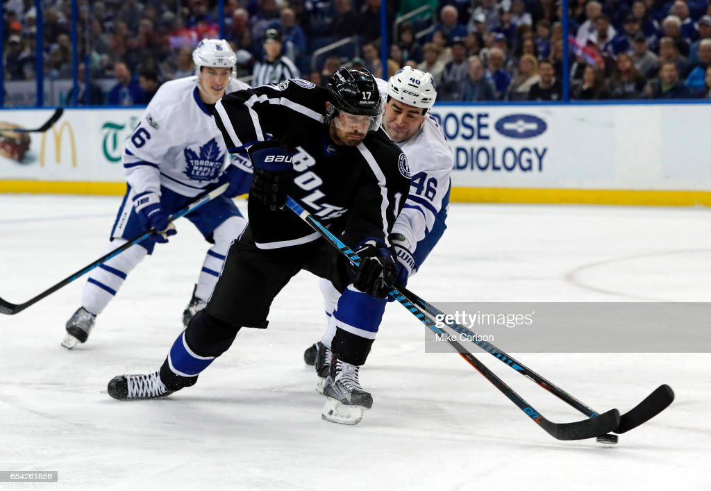 Alex Killorn #17 of the Tampa Bay Lightning tries to shoot past Roman Polak #46 of the Toronto Maple Leafs during the second period at the Amalie Arena on March 16, 2017 in Tampa, Florida.