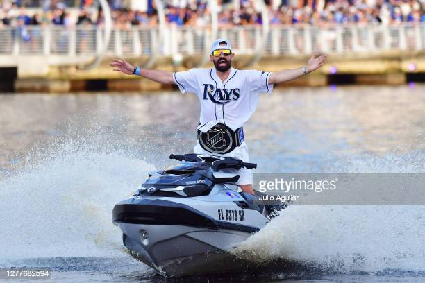 Alex Killorn of the Tampa Bay Lightning waves to the crowd from his jetski during during the Tampa Bay Lightning Victory Rally & Boat Parade on the...