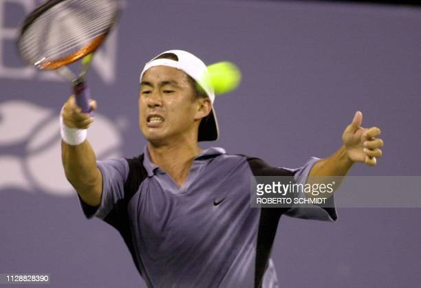 Alex Kim of the US returns a forehand during his first round Men's singles match against Andre Agassi of the US in the US Open tennis tournament in...