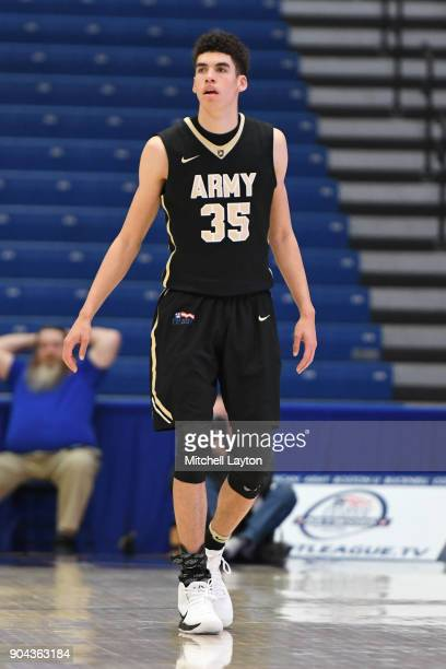 Alex King of the Army Black Knights looks on during a college basketball game against the American University Eagles at Bender Arena on January 8...