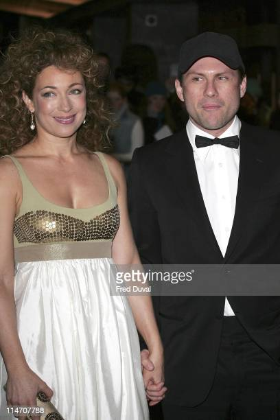 Alex Kingston and Christian Slater during 2006 Laurence Olivier Awards Arrivals at London Hilton in London United Kingdom