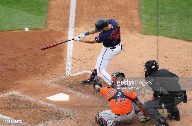 Alex Kirilloff of the Minnesota Twins singles in the fourth inning of his Major League debut against the Houston Astros during Game Two of the...