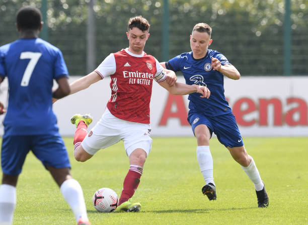 Alex Kirk of Arsenal takes on Jayden Wareham of Chelsea during the U18 Premier League south match between Arsenal u18 and Chelsea U18 at London...
