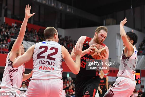 Alex Kirk of the Alvark Tokyo handles the ball under pressure from the Kawasaki Brave Thunders defense during the BLeague match between Alverk Tokyo...