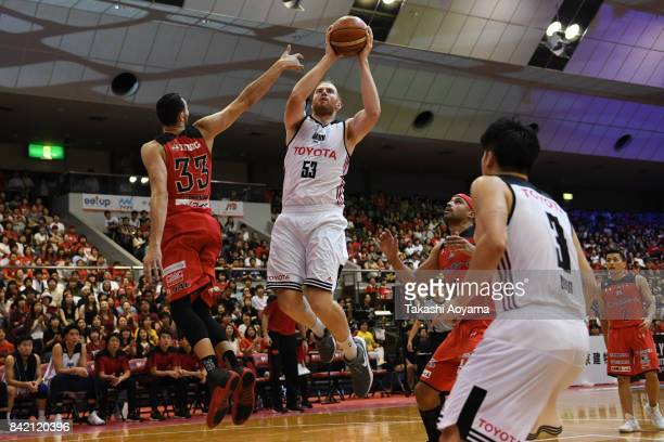 Alex Kirk of the Alvark Tokyo shoots while under pressure from Tony Gaffney of the Chiba Jets during the BLeague Kanto Early Cup final between Alvark...