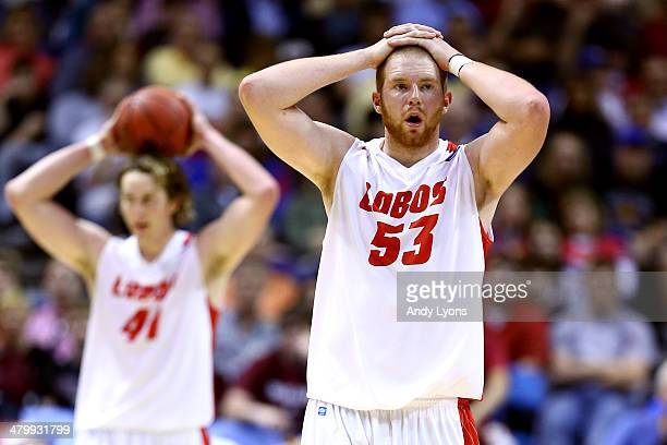 Alex Kirk of the New Mexico Lobos and teammate Cameron Bairstow react in the second half against the Stanford Cardinal during the second round of the...