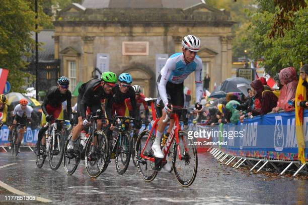Alex Kirsch of Luxembourg / Jay Robert Thomson of South Africa / Luis Leon Sanchez of Spain / Peloton / Rain / during the 92nd UCI Road World...