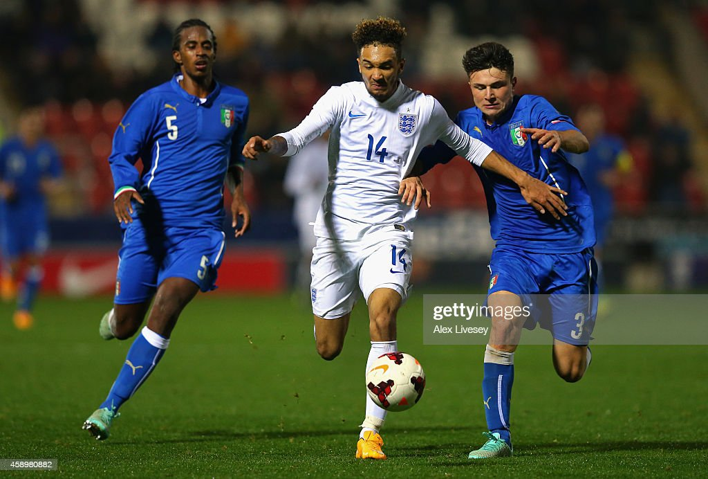 Alex Kiwomya of England U19 beats Alessio Lo Porto of Italy U19 during the International friendly match between England U19 and Italy U19 at The New York Stadium on November 14, 2014 in Rotherham, England.