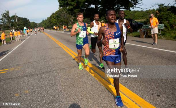 Alex Korio leads the pack of men elite runners followed by from right Jairus KipchogeBirechalong Bashir Abdi and Brett Robinson in the annual Beach...