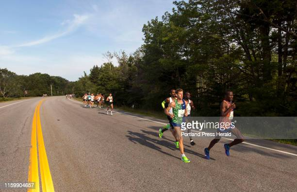 Alex Korio pulls ahead of the pack of elite men just down the hill from the starting line in the annual Beach to Beacon on Saturday August 3 2019...