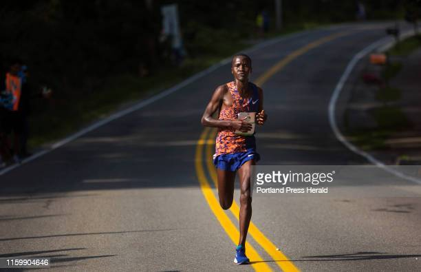 Alex Korio runs along Shore Road after breaking away from the other men elite runners in the annual Beach to Beacon 10k on Saturday August 3 2019...