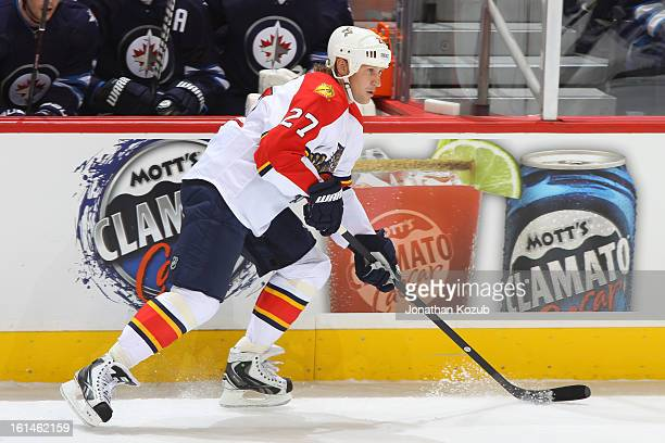 Alex Kovalev of the Florida Panthers carries the puck along the boards during first period action against the Winnipeg Jets at the MTS Centre on...