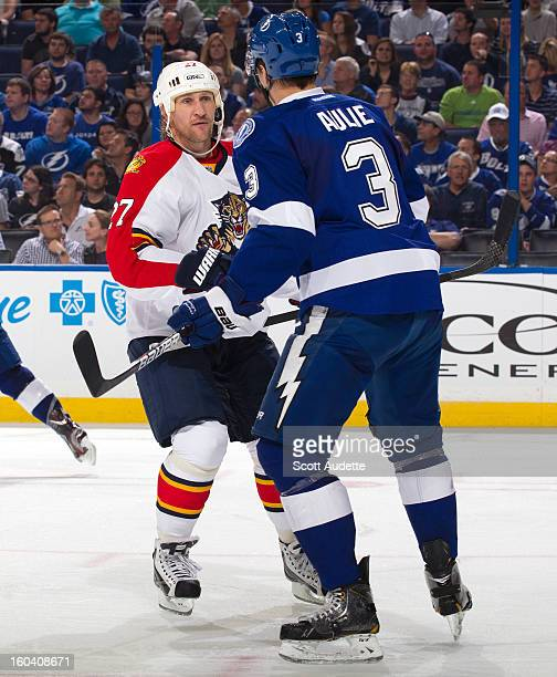 Alex Kovalev of the Florida Panthers confronts Keith Aulie of the Tampa Bay Lightning at the Tampa Bay Times Forum on January 29 2013 in Tampa Florida