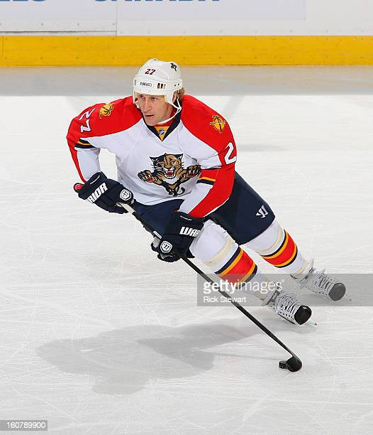 Alex Kovalev of the Florida Panthers skates the puck against the Buffalo Sabres at First Niagara Center on February 3 2013 in Buffalo New York...
