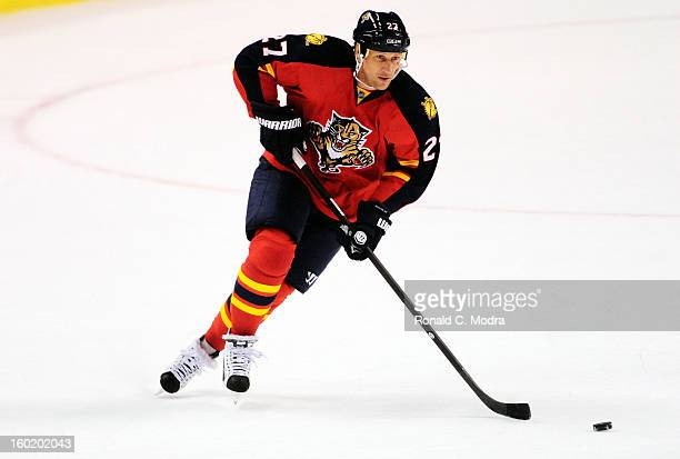 Alex Kovalev of the Florida Panthers skates with the puck during a NHL game against the Ottawa Senators at the BBT Center on January 24 2013 in...