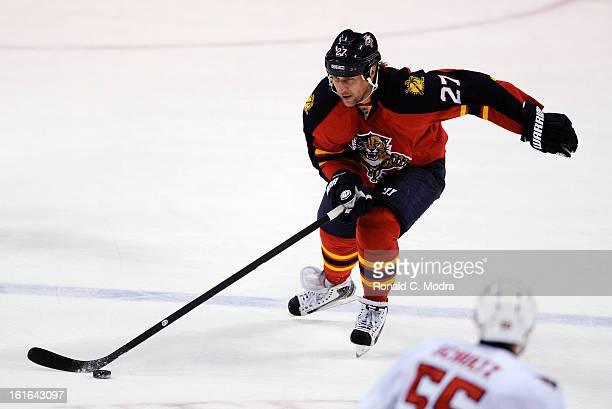 Alex Kovalev of the Florida Panthers skates with the puck during a NHL game against the Washington Capitals at the BBT Center on February 12 2013 in...