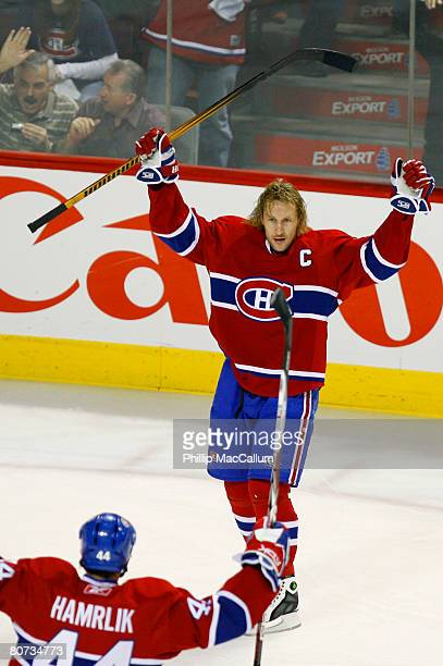Alex Kovalev of the Montreal Canadiens celebrates his goal against the Boston Bruins with teammate Roman Hamrlik during game five of the 2008 Eastern...