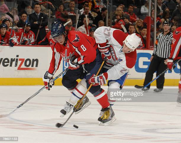Alex Kovalev of the Montreal Canadiens fights for a loose puck during a hockey game against Alex Ovechkin of the Washington Capitals at the Verizon...