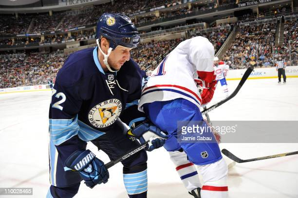 Alex Kovalev of the Pittsburgh Penguins gets tangled up with Lars Eller of the Montreal Canadiens while battling for a loose puck on March 12 2011 at...