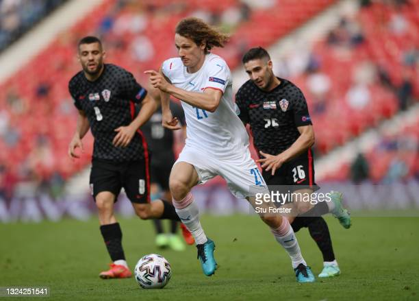 Alex Kral of Czech Republic runs with the ball whilst under pressure from Mateo Kovacic and Luka Ivanusec of Croatia during the UEFA Euro 2020...