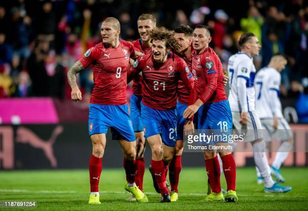 Alex Kral of the Czech Republic celebrates with teammates after scoring the equalizer during the UEFA Euro 2020 Qualifier between Czech Republic and...