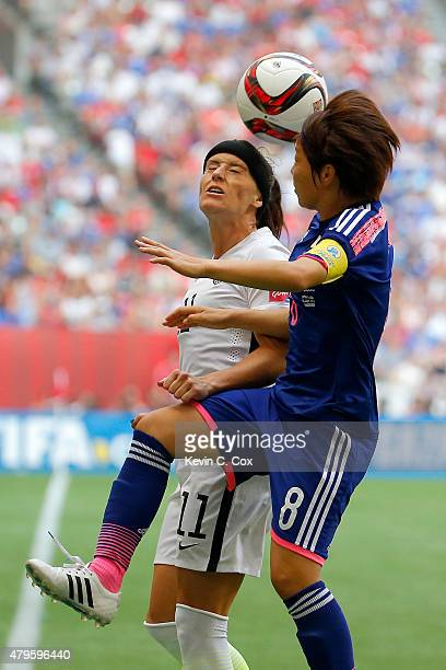 Alex Krieger of the United States heads the ball against Aya Miyama of Japan in the second half in the FIFA Women's World Cup Canada 2015 Final at BC...
