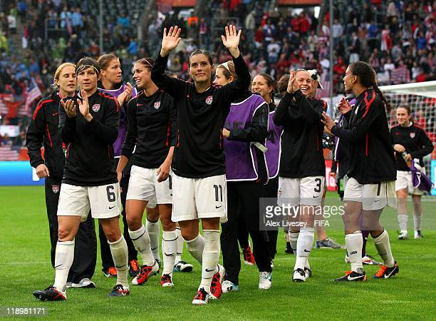 Alex Krieger of USA along wit team mates celebrates at the final whistle after victory over France in the FIFA Women's World Cup Semi Final match...