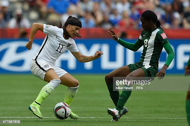 Alex Krieger of USA is challenged by Asisat Oshoala of Nigeria during the FIFA Women's World Cup 2015 Group D match between Nigeria and USA at BC...