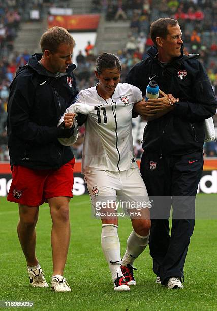 Alex Krieger of USA is helped off with a injury during the FIFA Women's World Cup Semi Final match between France and USA at BorussiaPark Stadium on...