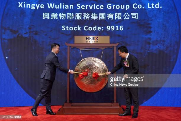 Alex Kwok Pak Shing , Chief Financial Officer of Zensun Enterprises Limited, and another representative attend the listing ceremony of Xinye Wulian...