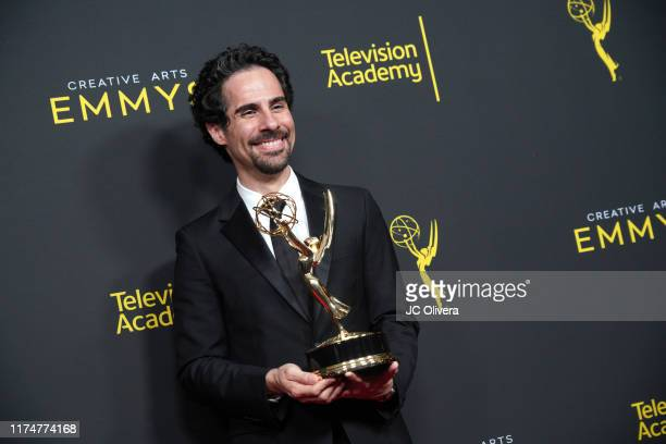 Alex Lacamoire poses in the press room with the award outstanding music direction for 'Fosse/Verdon' during the 2019 Creative Arts Emmy Awards on...